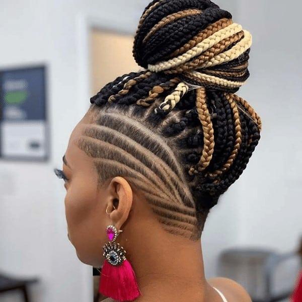 Edgy shaved hair with a braided bun