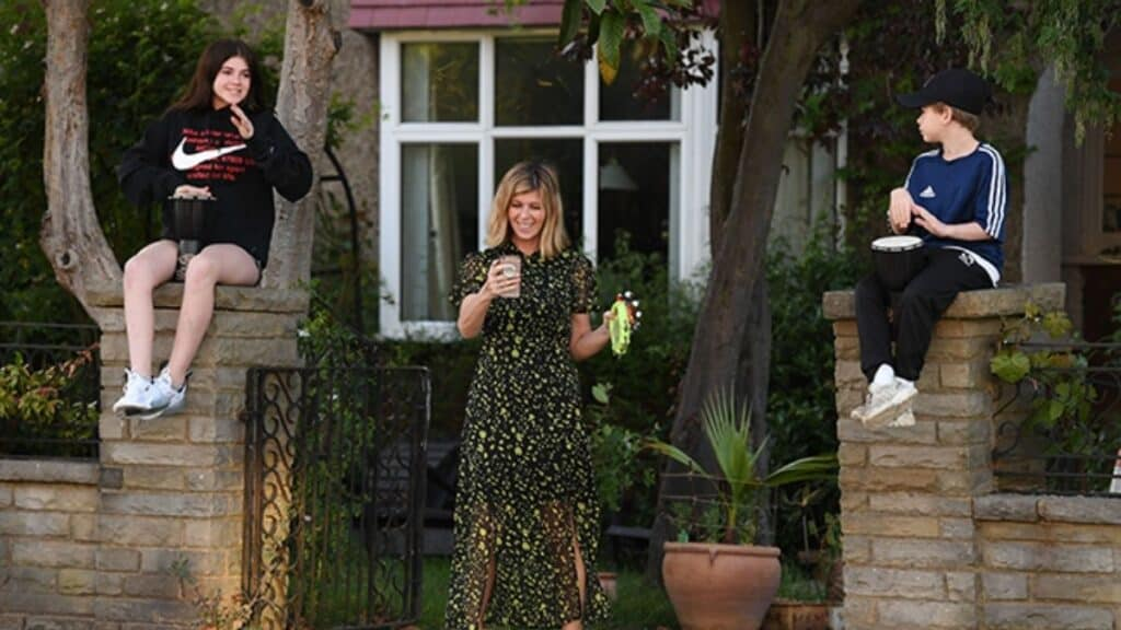 The TV star pictured with Darcey and Billy outside their family home